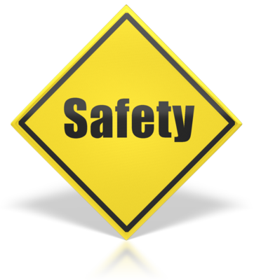 """yellow caution sign that reads """"safety"""""""